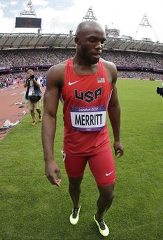 United States' LaShawn Merritt walks in the infield after pulling out with an injury from a men's 400-meter heat.