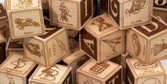 A geeky dad made a set of alphabet blocks for his future geeky son