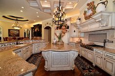 "I love the cabinets, granite, general shape and rugs in this kitchen! Also the ""mantle""."