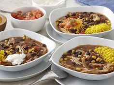 Use your slow cooker for tender, flavor-infused chicken enchilada soup. Serve with yellow rice, pico de gallo, sour cream, cheddar cheese and tortilla strips.