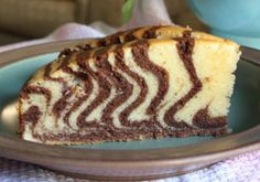 zebra cake recipe and directions with pictures  - this turned out delicious and it was easy.  We added purple frosting.