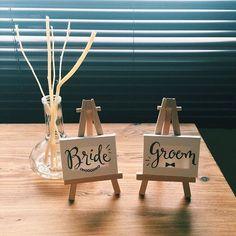 今日も今日とて追い込んでます ムービー書き出しの合間に、受付サイン(๑´`๑) #flyingtiger で買ったミニキャンバス+イーゼルにマッキーで描きました¨̮ #結婚式準備 #プレ花嫁 #2016春婚 #2016swd #20160326wedding #受付飾り #結婚式受付 #handlettering #weddingdiy