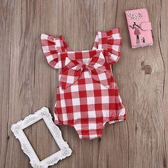 Birthday party: theme - teddy bears picnic. Great cotton outfit, with a bow (except this comes on a safety pin, so would need to pin to an elastic headband or hat for a young child).  There are no poppers on the bum, but it's still easy to wear.  Great quality for the price.