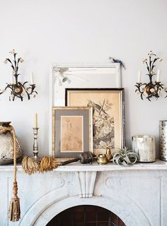 marble fireplace with mantel styled with vintage floral sconces, art, vessels and tassels. romantica sfgirlbybay / bohemian modern style from a san francisco girl Interior Styling, Interior Decorating, Interior Design, French Interior, Style At Home, Home Decor Accessories, Decorative Accessories, Home Decoracion, Marble Fireplaces
