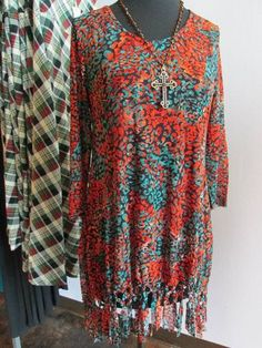 $69 Sizes: S-XL  Great Tunic for the Holidays!! Fringe bottoms gives this tunic a flare!! Orange & Turquoise - Great color combo!!
