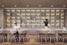 Image 22 of 53 from gallery of Mogan Academy / gad·line+ studio. Photograph by ingallery Studios Architecture, Interior Architecture, Pool Paving, Nendo Design, Book Bar, Modern Shelving, Open Office, Wood Panel Walls, Co Working