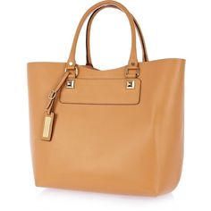Polish off your look with some dreamy tangerine in this peach structured leather tote bag. In a super functional size without sacrificing on style - this featu…