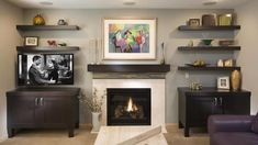 Contemporary great room designed fireplace and built ins with television