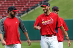 pitchers Adam Wainwright jokes with Jake Westbrook during practice a day before the opening of the NLCS against the Dodgers 10-10-13