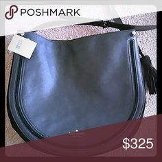 Kate spade hand bag This ia a brand-new bag never been used tag attached color is black leather with suede along the side edge kate spade Bags Shoulder Bags