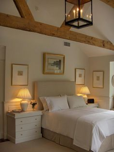 Pretty master bedroom by F. D Hodge Interiors