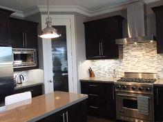 dark kitchen - LOVE the backsplash!