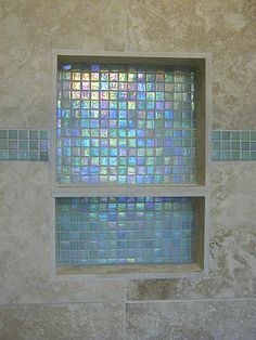 I like the use of the small glass tiles in the back of the niche and in the accent band