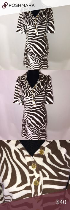 Tory Burch brown and white animal print dress Tory Burch brown and white animal print dress  Sleeves 15' Length 33 Pit to pit 20' Dress has slight stretch Gold buttons Tory Burch Dresses Mini
