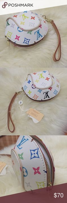 """Louis Vuitton monogram Ellipse clutch wristlet Brand new with tags & has never been used! This clutch is not real. It is like a mini version of the larger bag. Features rainbow monogram. Zipper top opens to one large compartment. Lined in faux red suede. Removable wristlet strap. Measures 6""""x5.5""""x3"""" and cannot fit an iPhone. Price reflects authenticity 😉 Bags Clutches & Wristlets"""