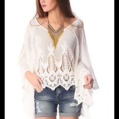 WHITE CROCHET LACE PONCHO TOP White poncho top in fine-knit crochet lace. Round neckline with wide-cut cuffs and scalloped edges. 100% Cotton Model is wearing size U. Relaxed Fit. Tops
