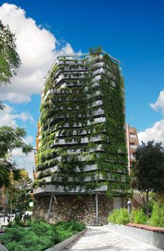 The Green Side-Wall consists of a free-standing structure containing plants that form a protective mass of vegetation against a facade in Barcelona, thus creating a vertical garden. The demolition of an old building left a former party wall visible f Green Architecture, Sustainable Architecture, Sustainable Design, Landscape Architecture, Green Facade, Vertical Farming, Vertical Gardens, Exterior, Facade Design