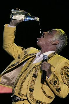 "Mexican singer Vicente Fernandez drinks ""Aguardiente,"" a Colombian liqueur derived from sugar cane, during a concert in Cali, Colombia. Spanish Music, Latin Music, Mexican Heritage, My Heritage, Mexican American, Mexican Art, Mexican Stuff, Brown Pride, Chicano Art"