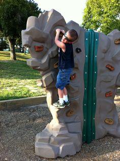 Hunter climbing the wall @ the park.