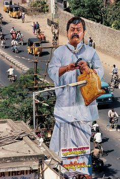Giant film cut-out placed on one of the main commercial streets of Chennai in Chennai, India.