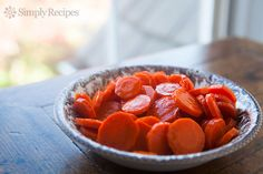 Maple Orange Glazed Carrots ~ Rounds of carrots, sautéed in butter and glazed with maple syrup and orange juice. Perfect for the holidays! ~ SimplyRecipes.com