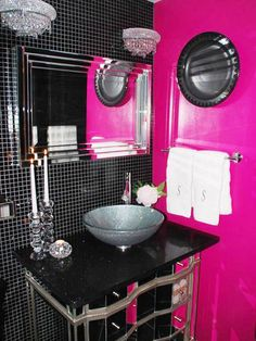 Rock Star Glamour RMS user lisaann19672002 transformed her guest bathroom with edgy rock-star decor. The now-glam bathroom features silver silk drapes, floor-to-ceiling black tile, a glittery vessel sink and a solid hot pink wall for a dramatic splash of color in this mostly black space.