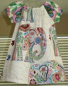 This dress has some style!  All in for girls this spring:  elephants, mixed prints, Africa, a-line,