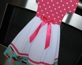 PLEASE NOTE: SEVERAL OF MY ITEMS HAVE BEEN COMMISSIONED TO A LOCAL GIFT SHOP. IF INTERESTED IN THIS ITEM, PLEASE CHECK AVAILABILITY PER ETSY CONVO BEFORE PURCHASING TO ENSURE THAT IT HAS NOT BEEN SOLD OUT. THANK YOU!!    From the Sweet Tooth Cupcake Retro Collection...    Coordinates with the Vintage Inspired Sweet Tooth Cupcake Retro Apron. Dress Up your kitchen with this pretty little hanging dishtowel dress. Handmade from 100% cotton dishtowel and fabric, the dishtowel dress is…