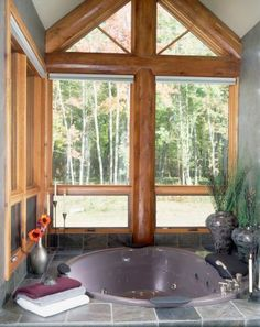 I love this sunken tub with huge windows.