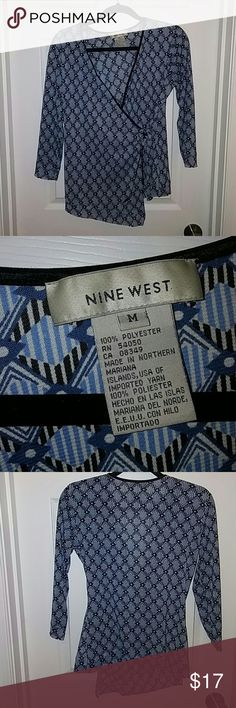 Nine West sheer faux wrap shirt Light weight, semi sheer faux wrap shirt with flower detail.  Blue, back and white geometric design.  Worn a couple of times.  Size medium. Nine West Tops Blouses