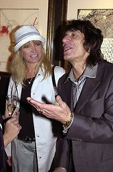 RONNIE & JO WOOD, he is the Rolling Stone, at an<br />  exhibition in London on 24th May 2000.OEM 34<br /> © Desmond O'Neill Features:- 020 8971 9600<br />    10 Victoria Mews, London.  SW18 3PY <br /> www.donfeatures.com   photos@donfeatures.com<br /> MINIMUM REPRODUCTION FEE AS AGREED.<br /> PHOTOGRAPH BY DOMINIC O'NEILL