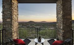 Interior Exquisite Arizona Desert Mountain Retreat With Comforting Views: Interesting Design Of Balcony In New Building With Black Balcony In Stell Plus Great Wall In Stones Plus Two Black Balcony Chair With Red Chusion Plus White Floor In Marble