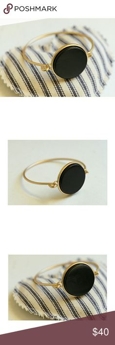 """LA Indy Designer Black Stone/Eco-Friendly Bracelet This is a beautiful black stone set in brushed-gold-plated (satin finish) brass, with a simple hook enclosure. This is stunning; I bought one for myself with a solid white stone, and get so many compliments on its classic, minimalist design, courtesy of """"Tigua"""" here in LA. Completely lead- and nickle-free. NEW. Enjoy! Designer Jewelry Bracelets"""