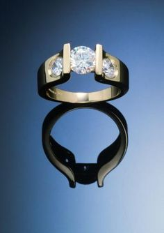Gold and Diamond (1.00ct. center .66ct sides) Contemporary Three Stone Ring, a Copyrighted Original by Thomas Michaels Designers, Inc.
