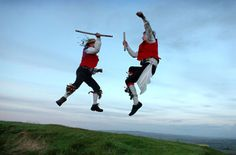Members of  Wyvern Jubilee Morris  dancing as the sun rises at Ham Hill on 1 May 2008.  Picture by Len Copland, in the Western Gazette.