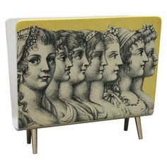 Piero Fornasetti Magazine Holder, 1950 // If that date is correct, that is _very_ retro before its time.
