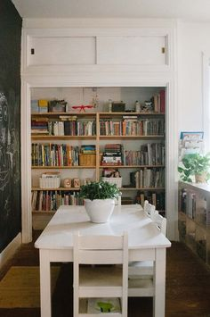 "A Bright and Airy Home in Central Texas | Bethany's boys' room was so large, they chose to ""divide"" it with bookshelves to create a little school area. Bethany's father and Mark built the closet to create a bookshelf for all of their children's books and then painted the wall with chalkboard paint for anything from lists to silly drawings. (14 of 20)"