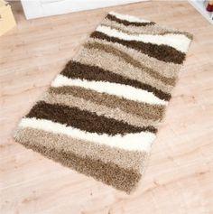 """Der moderne Teppich """"Rio"""" ist in sieben verschiedenen Designs bei uns im Teppich-Shop zu bestellen.Die farbig, verspielten Motive lockern Ihre eigenen vier Wände auf. Der Shaggy Teppich hat ein hat Gesamtgewicht von 3100 g/m² und besteht aus 100 % Polypropylen. Dadurch ist er äußerst pflegeleicht und einfach zu reinigen."""
