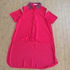 Very pretty red shirt Worn twice. Cut out shoulders. 100% Polyester. Tops