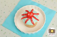 octopus cupcake made from a red jordan almond, taffy and black gel food coloring.