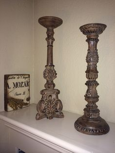 Large 18'-20' Candle sticks made of resin looks like carved wood with a beautiful antique finish.  Place them at the hearth of your fireplace.  The pair $68 that's only $34 each  SOLD