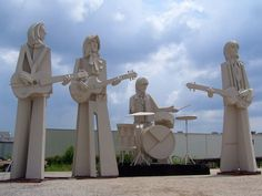 The Beatles Statue by David Addicks in Houston, TX, atop the Katy Freeway ~ How cool is this ~