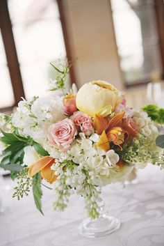 Centerpieces were composed of blush peonies, white hydrangea, gold roses, seeded eucalyptus and herbs.