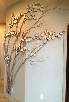 nice idea to add a tree to your place without taking up space. with or without the sliced wood. i would instead use garlands to weave in the branches of sesonal flowers or leaves..that way the tree is always changing. can just imagine what this could look like at xmas.