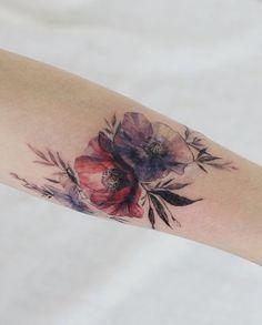 Flower tattoo by tattooist Flower