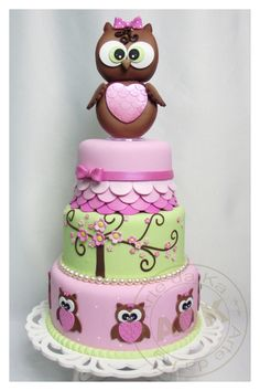 Adorable owl cake tiered in pastel pink & green with tree and owl decoration! Great #CakeDecorating!