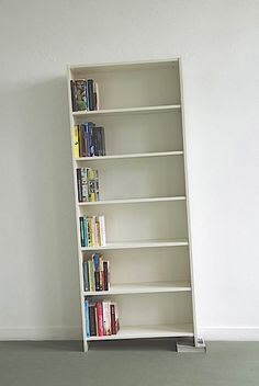I love the quirkiness of this.  (it happens to be ikea's 'billy' bookcase -- which comes in dark finishes, too.)