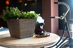 MENHARD STORE IN SIBIU BY GLAMSHOPS Visual Merchandising, Sibiu Romania, Leather Store, Store Design, Planter Pots, Vintage, Interior Design, Bicycle, Jeans