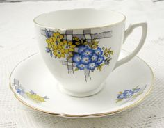 Melba Hand Painted Tea Cup and Saucer with Blue Flowers and Green Trim