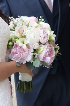 The Bridal Bouquet in soft hues of blush, nude and ivory shades, a collection of Ivory and Blush Pink Peonies, David Austin's Keira Roses with Quicksand and Mentha, ivory Freesia, Thalaspi, Sweet Peas, Umbrella Fern and Eucalyptus